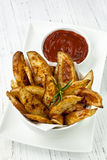 Potato Wedges with Ketchup Royalty Free Stock Images