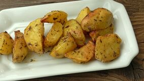 Potato wedges, oven roasted, with thyme