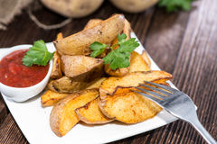 Potato Wedges with Parsley and Sauce Stock Image