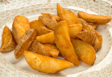 Potato wedges Stock Photography
