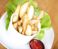 Potato Wedges on plate Stock Image