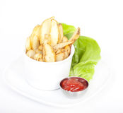 Potato Wedges on plate served with ketchup Stock Photography