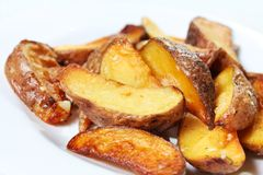 Potato wedges roasted in their skins Royalty Free Stock Photos