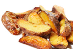 Potato wedges roasted in their skins Stock Image