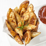 Potato Wedges with Rosemary and Ketchup Royalty Free Stock Images