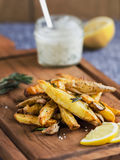 Potato wedges with rosemary and sea salt Stock Photos