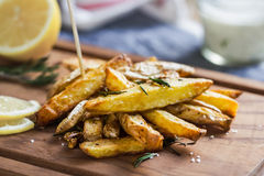 Potato wedges with rosemary and sea salt Royalty Free Stock Images