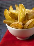 Potato wedges in a white bowl Royalty Free Stock Photos