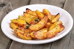Potato wedges on white plate Stock Photos
