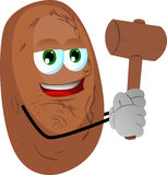Potato with a wooden hammer Royalty Free Stock Photography