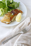 Potato Wrapped Cod. With a lemon wedge Stock Photography