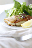 Potato Wrapped Cod. With a lemon wedge Royalty Free Stock Photo