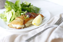 Potato Wrapped Cod. With a lemon wedge Royalty Free Stock Images