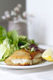 Potato Wrapped Cod. With a lemon wedge Stock Images