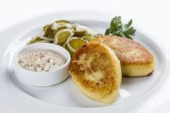 Potato zrazy on a white plate royalty free stock photography