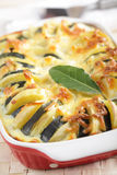 Potato and zucchini gratin. In the baking dish stock photos