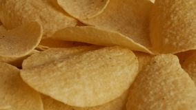 Potatoe chips in UHD. UHD of classic potatoe chips on the rotating stand stock footage