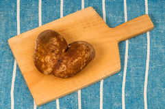Potatoe in heart shape Stock Images