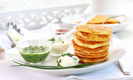 Potatoe pancakes with three dips Stock Photos