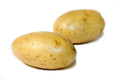 POTATOES. Some yellow potatoes isolated on white background Stock Photos