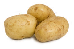 Potatoes. Three potatoes isolate on a white background Royalty Free Stock Image