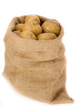 Potatoes. In burlap bag agaist white background Royalty Free Stock Images