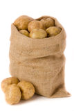 Potatoes. In burlap bag agaist white background Royalty Free Stock Photos