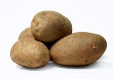 Potatoes. Four whole fresh potatoes food Stock Photo