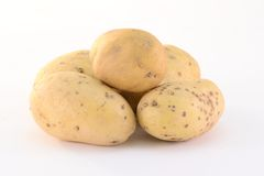 Potatoes. Stack of potatoes isolated on white background Stock Photo
