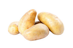 Potatoes. Five potatoes over a white background Stock Images