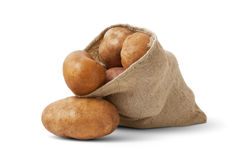 Potatoes. Bag potatoes on white background Royalty Free Stock Image