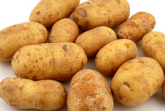 Potatoes. Fresh potatoes in front of a white background Royalty Free Stock Photos