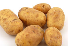 Potatoes. Fresh potatoes in front of a white background Royalty Free Stock Images