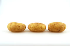 Potatoes. Fresh potatoes in front of a white background Stock Photos