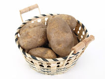 Potatoes. A wicker basket full of large baker potatoes. Over a white background Stock Photos