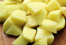 Potatoes. Pieces of potatoes in the kitchen Royalty Free Stock Photo