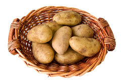 Potatoes. Some potatoes in basket isolated on white background stock photography