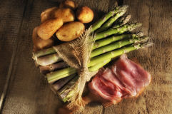 Potatoes, aparagus and ham royalty free stock image