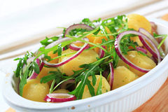 Potatoes with arugula and onion Royalty Free Stock Photo