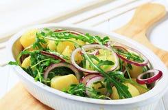 Potatoes with arugula and onion Royalty Free Stock Photo