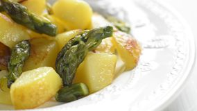 Potatoes with asparagus stock video footage