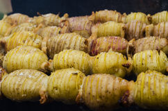 Potatoes with bacon on skewers. Potato with bacon on skewers cooked at the stake Stock Photos