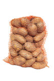 Potatoes in bag. Royalty Free Stock Photo