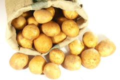 Potatoes in bag. Raw potatoes in bag isolated on white Stock Photos