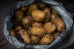 Potatoes in a bag. On the counter in the sale Stock Images