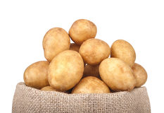 Potatoes in the bag isolated on white background. royalty free stock photo