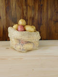 Potatoes in a bag Stock Images