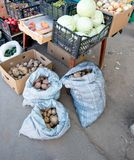 Potatoes in bags, fruit and vegetables stall in Royalty Free Stock Photography