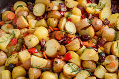 Potatoes baked with bacon. Homemade food preparation. Royalty Free Stock Images