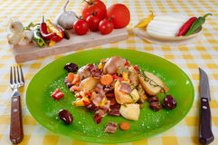 Potatoes baked with bacon served on plate. Homemade food preparation. Stock Photography